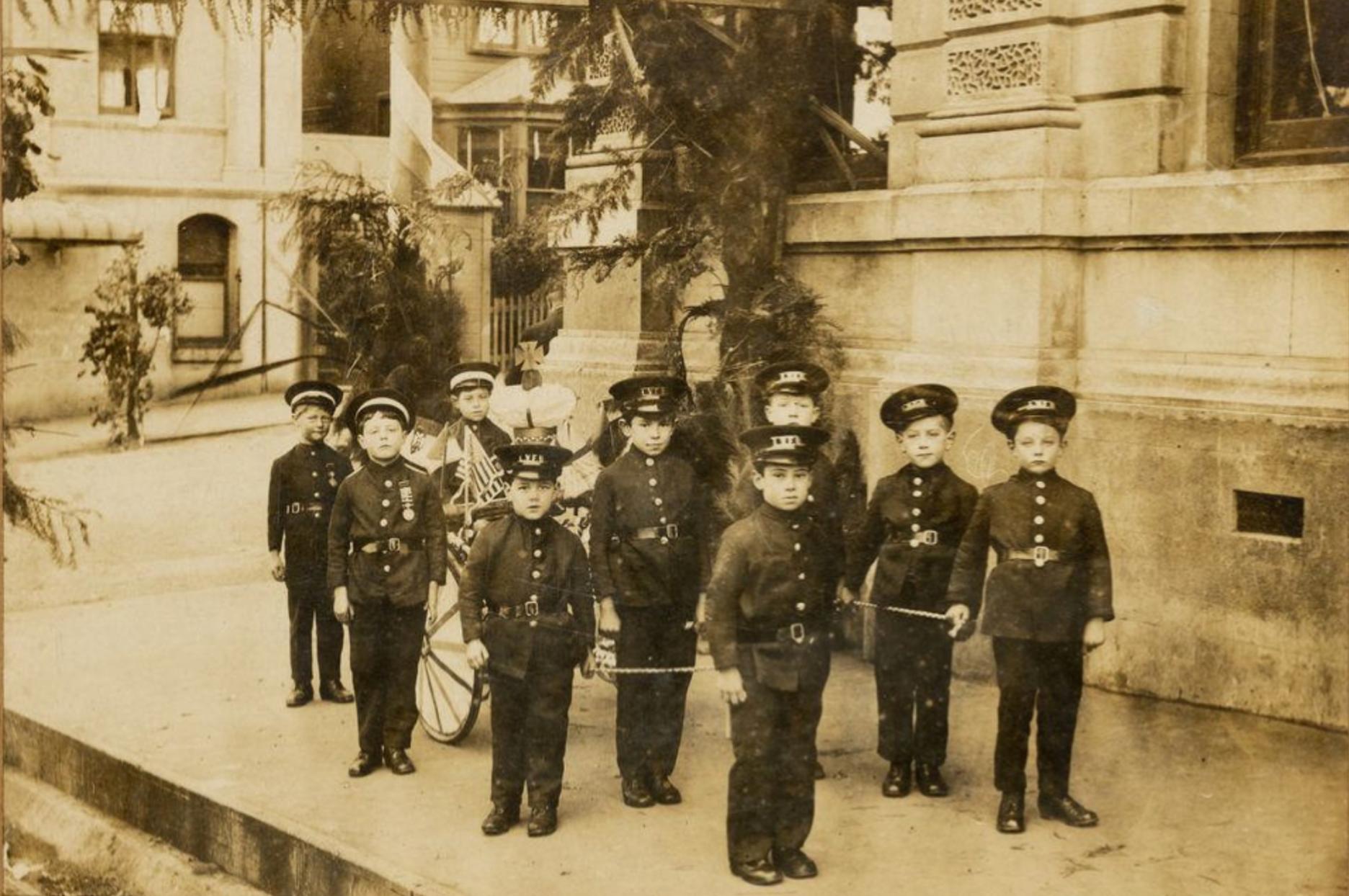Nine young boys dressed in Lyttelton Volunteer Fire Brigade uniforms - 14978.1
