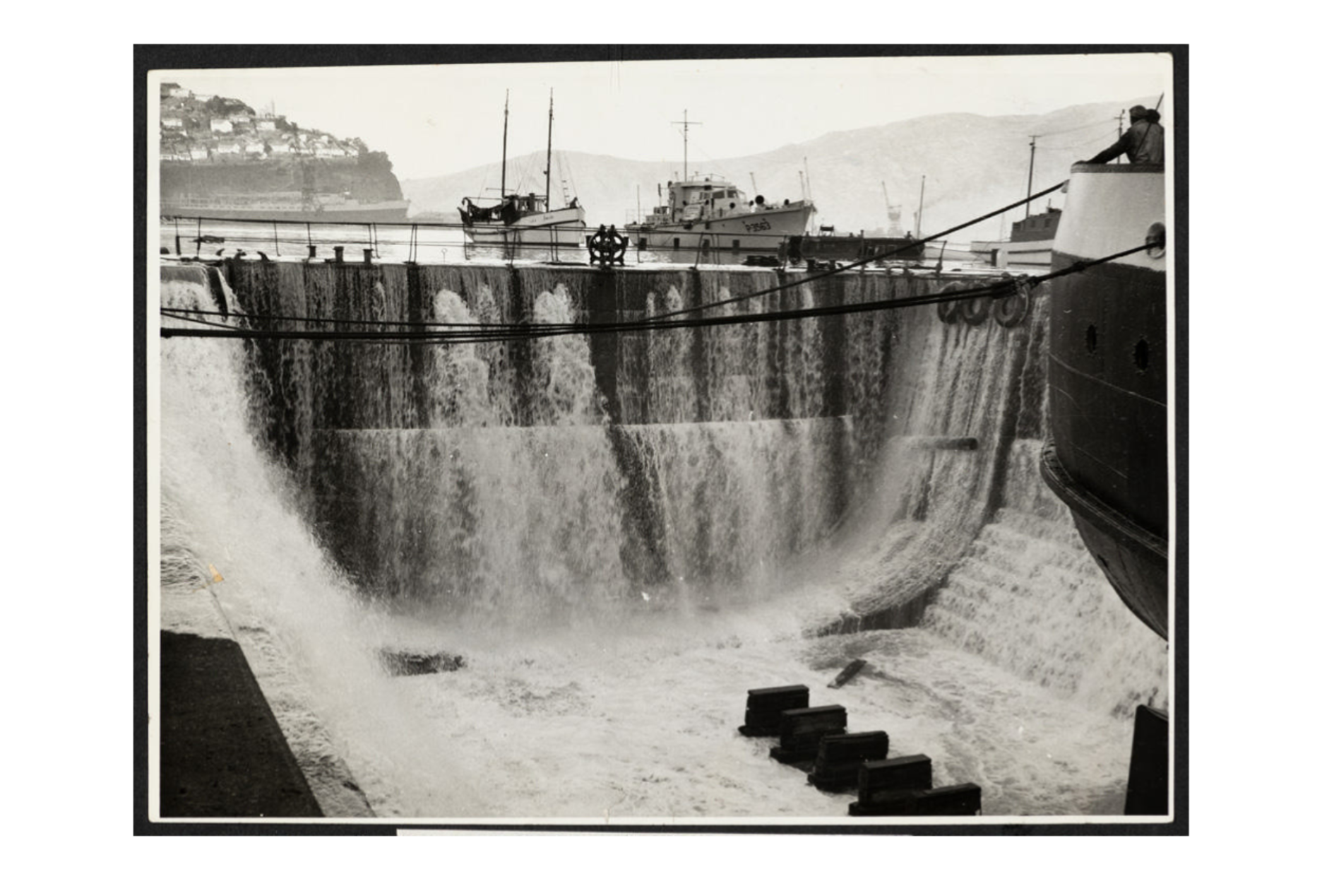 Water pouring into the Graving Dock at Lyttelton Port during the 23 May 1960 Tsunami