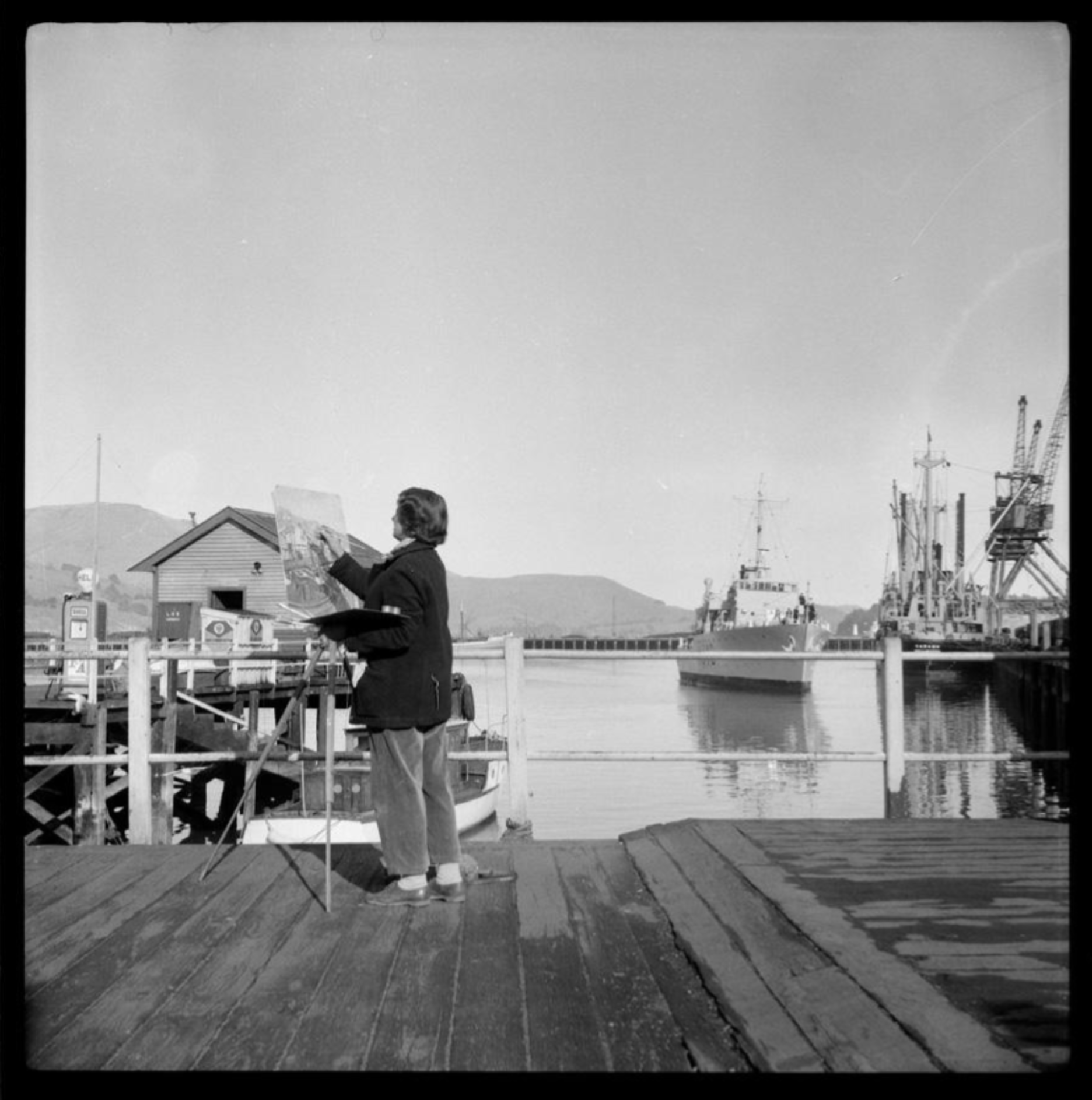 Woman painting on wharf at Lyttelton - 6536.1